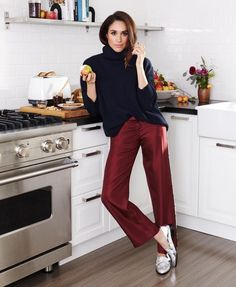 Neat sweater; jewel tone pants More