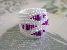 Herringbone Ring in White and Fuschia Beaded Beadwoven Seed Bead Ring - Size 5, 6, 7, 8, 9, 10, 11, 12, 13. $17,00, via Etsy.