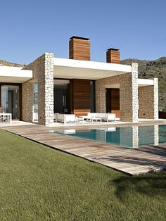 Valencia-based studio Ramon Esteve has designed a two story contemporary home.