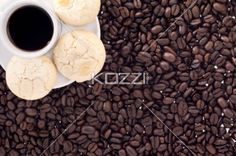 top view of coffee cup with cookies and beans. - Overhead view of coffee cup with coffee beans and cookies.