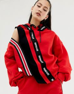 d038efcc7 Shop Ivy Park Spliced Stripe Cutout Hoodie In Red at ASOS.