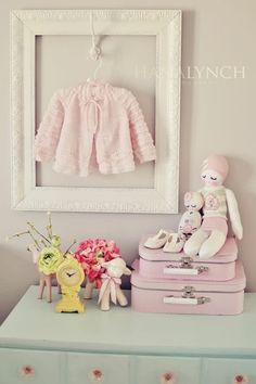 frame clothes by hanging in front of empty frame. So cute in baby room or toy room!