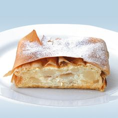 The milk-cream strudel (Viennese: Millirahmstrudel, German: Milchrahmstrudel) is a traditional Viennese strudel. It is a popular pastry in Austria and in many countries in Europe that once belonged to the Austro-Hungarian empire (1867–1918). The milk-cream strudel is an oven-baked pastry dough stuffed with a sweet bread, raisin and cream filling and served in the pan with hot vanilla sauce.