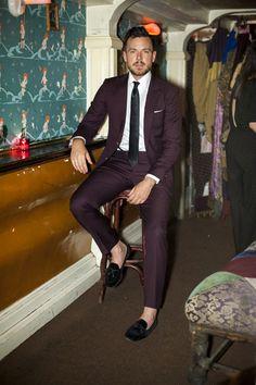 Burgundy suit.