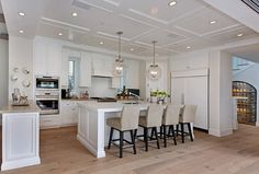 """Lighting is the """"Regina Andrew Large Globe Pendants in Nickel Finish"""".  The Island is approx. 5′ x 10′.  Relaxed California Beach House with Coastal Interiors"""