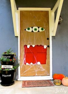 7 Halloween Front Door DIYs That Are Sure to Get Noticed by Trick-or-Treaters - Super excited about this coverage by PopSugar - Click in for some fantastic Halloween door decor ideas with how-tos!