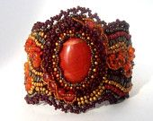 Bead embroidered cuff bracelet with red jasper