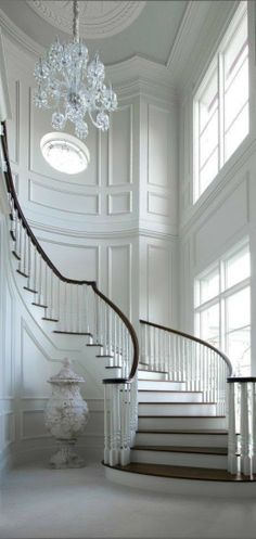 Stunning architectural details surround this spiral staircase.