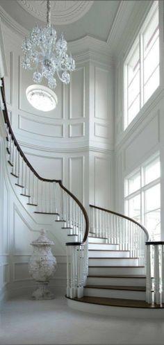 Stunning architectural details surround this spiral staircase.