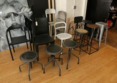 """Large decorative storage unit measuring approx 71""""x10""""x83""""t, steel construction with wooden box style cubbies, Chairs, adjustable height stools, high stools, stacking chairs and folding chairs, remaining items lot including large metal frame wood and Formica top L table measuring approx 60""""x235""""x30""""t, two red lounge chairs in the entry way that measure approx 27""""x27""""x27""""t, a black metal construction hat rack"""