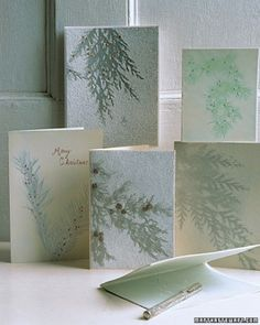 Evergreen Christmas Cards - place evergreen branches on card and spray white. Remove the branch to leave a silhouette
