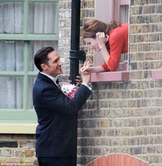 She said YES! Tom, plays Reggie in the new Kray biopic and can be seen proposing to France...