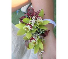 Mother of the Bride Wrist Corsage of Green a Cymbidium Orchids and White Waxflower
