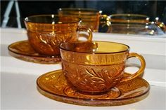 Tiara amber sandwich glass coffee cups