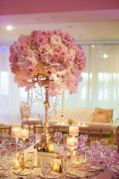 Photographer: She Wanders Photography; Luxury pink and white flower wedding reception centerpiece with gold stem;