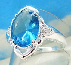 ' Blue Topaz 18K White Gold Filled Ring' is going up for auction at  1am Sat, Nov 3 with a starting bid of $5.