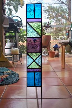 Natural Elements Multi-Color Stained Glass Garden or Plant Stake. $48.00, via Etsy.