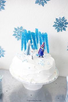 frozen birthday cake with elsa and anna and olaf on top