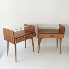 PAIR OF LOVELY & DECORATIVE MID CENTURY MODERN BEDSIDE TABLES MANUFACTURED BY WK-MÖBEL, GERMANY IN 1950s | HELMUT MAGG ERA  DATE OF PRODUCTION STAMPED: 25th MAY 1957 (25. MAI 1957)  Up for sale a pair of lovely and decorative mid century modern bedside tables with elegant details. Manufactured in 1957 by WK-Möbel, Germany. Makers mark inside the drawer.  Attention: For a safe transport, the tables will be dismantled as far as possible!  MATERIAL: Walnut, glass and plywood handle…