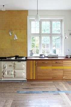 Love the blue tile inset into the wood floor.   Retrouvius update - desire to inspire - desiretoinspire.net