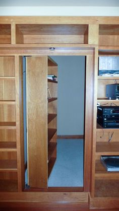 Hidden Bookcase Door - Hideout in your Panic Room - awesome! Detailed instructions for pivot door installation at This is Carpentry