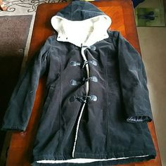 Beautiful cotton black coat Heavy duty beautiful cotton black coat, suits for a chilling winter.  Very fashionable while keeps you cozy and warm.  Like new, lightly worn! U2 Jackets & Coats