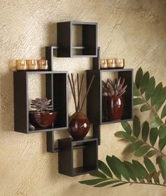 Squares placed to use as shelving for small plants, vases, and votives