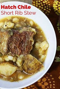 This beef short rib stew with hominy and potatoes is simple in seasoning relying on the unique flavor of Hatch Chile to flavor the dish. A simple stew of braised short ribs, chewy white hominy and chunks of potato. Perfect for a Winter night's meal. Hatch Green Chili Recipe, Green Chili Recipes, Beef Recipes, Mexican Food Recipes, Soup Recipes, Cooking Recipes, Hatch Chili, Hominy Recipes, Dinner Recipes