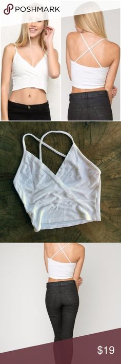 Brandy Melville Jasmine Tank Cross Back Size S Brandy Melville Jasmine Tank Cross Back Size S. Spaghetti strap with cross back detail. Perfect tank for a beachy california feel :) Brandy Melville Tops Tank Tops