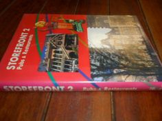 Buy STOREFRONT 2 -  PUBS AND RESTAURANTS (street facades) - GRAPHIC-SHA COLOUR 808 ILLUS HARDB1995for R55.00