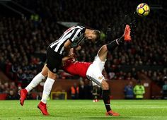 Newcastle United's Florian Lejeune and Manchester United's Juan Mata battle for the ball during the match at Old Trafford