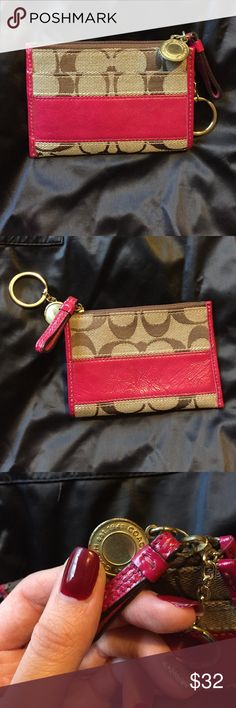 Coach Coin Purse Small Coach coin purse.. in good used condition, the exterior is very clean and the inside is pretty clean , no stains. The only flaw is the little Coach gold decor piece on the zipper is a bit scratched up (as seen in photo) ... pink tan and brown in color. It's super cute and great for travel! Coach Accessories Key & Card Holders
