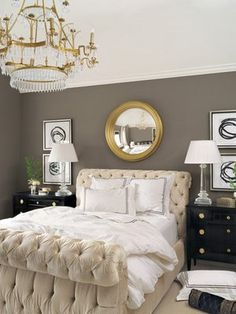 The sense of glamour, punctuated by restraint of classic pieces, and grounded by black bedside tables is the perfect balance of cozy yet formal. I also love that the design chose to go with a gold frame on the mirror, which is a surprising accompaniment to the taupe wall color, but a compliment to the chandelier. Love it!