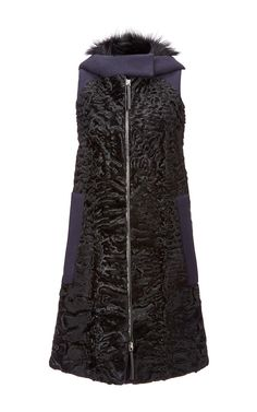 This sleeveless Marni vest is rendered in textured Persian Lamb fur and features a fur lined hood, two side welt pockets at the front, and a long silhouette with tonal wool trim throughout. Exposed zip front closure. Materials: genuine Persian lamb fur imported from Afghanistan. Color: black. (=)