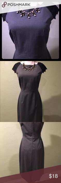 "Grey & Black Lace Dress Tahari grey sheath work dress with pretty black lace cap sleeves. Great work staple piece for all seasons. Hits right at the knee on me - I'm 5'4"". Excellent condition. Size 2 Petite. Tahari Dresses Midi"