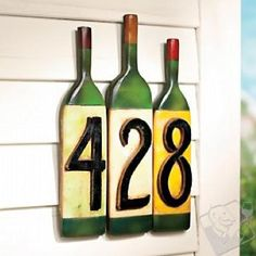 wine bottle house numbers.  Glass inspiration ... slump the bottles first, adhere to masonite and use my existing house numbers.  Totally do-able.