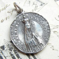 Our Lady of Fatima Medal Our Lady of the Rosary by rosamystica