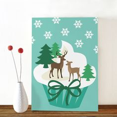Cute winter postcard with two deers on a cupcake by Oktoberdots