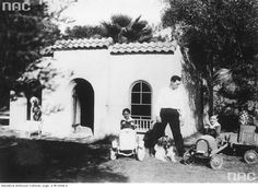 Buster Keaton Hollywood, 1931 with his boys (and Elmer) by their playhouse at the Villa