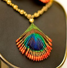 Hmmmm........ with careful attention to bead placement and size......just a thought!!..........Peacock Feather Set Handmade Jewellery from Heaven by nakshikatha