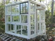 Greenhouse made from old windows. I've always wanted a greenhouse.  Maybe when we replace the windows?