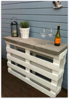 DIY pallet bar made with 2 pallets and 3 12x12 patio pavers. Paint or stain pallets to desired color and you could even paint or do a mosaic design on the pavers for added detail.