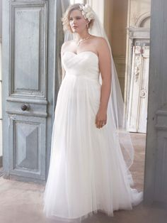 Magnificent is an understatement for this ruched tulle wedding dress. Long and soft, this delicate gown is simply gorgeous.Dot Tulle Empire Waist Soft Wedding Gown Style 9WG3438 #davidsbridal #weddingdress #aislestyle