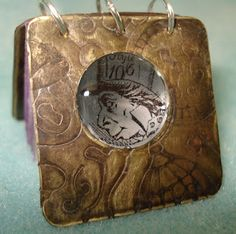 My stuff, my life - Mad as a Hatter resin and brass mini book