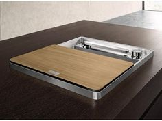 oh blanco. youre incredible! the sleekest stainless sink with retractable telescoping faucet and remote valve. - My Home Decor Kitchen Fixtures, Kitchen Sink, Compact Kitchen, Stainless Sink, Red Dot Design, Ceramic Sink, Design Awards, Cool Kitchens, Tiny Kitchens