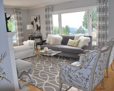 gray living room - I really dig the dark butterfly painting.