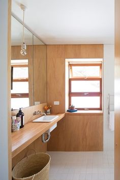The upstairs bathroom features a recycled hardwood vanity.