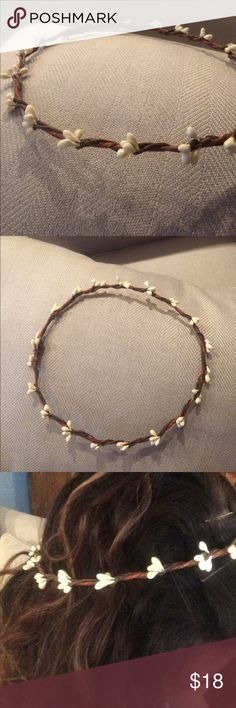 Simple handmade flower crown Got this on Etsy for my wedding but ended up with something else. It is handmade and the white buds are are a soft fake plastic (not shiney). The base ring is brown. It is very light and fits securely with a bobby pin. Accessories Hair Accessories