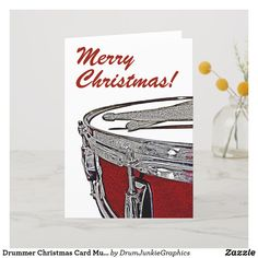 "A festive Drummer Christmas Card featuring a  red snare drum and crossed drumsticks with caption ""Merry Christmas"" - perfect holiday card for musicians #drummerchristmas #snaredrum #drumsticks #drumjunkie"