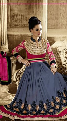 Trendy steel blue faux georgette and velvet designer salwar kameez which is completed with a stone, karachi embroidery work on the neck, moti, lace work below the yoke as well as border part, resham, zari embroidery work on the sleeves and lower part. This outfit comes with a matching bottom and contrast pink dupatta.This Salwar Kameez can be stitched in the maximum bust size of 42 inches, bottom length is 44 inches and Top length is 48 inches. Product Code  3FD4413868